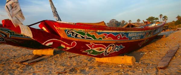 Traditional fishing boats on the sand.