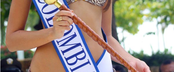 The sash and sexy midriff of a Miss Colombia pageant winner.