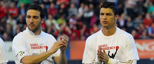 Portuguese stud Cristiano Ronaldo can be seen on the right preparing to take the pitch for Real Madrid.