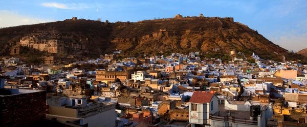 A view of Bundi and its blue buildings with the hillside fort in the background.