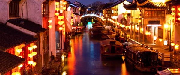 A nighttime view of Shan Tang Street and its picturesque canal.