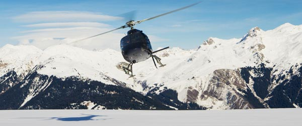 Use helicopters to access Alaska's backcountry and ski its slopes.