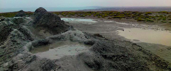 The Gobustan mud volcanoes with the Caspian Sea in the distance.