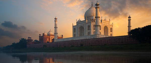 The Taj Mahal at sunrise as seen from the Mentab Bagh Gardens.