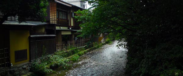 Wooden buildings and small canal in the historic neighborhood of Gion.