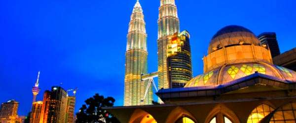 The Asy-Syakirin Mosque with the Petronas Twin Towers.