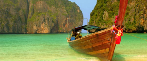 Traditional Thai longboats remain a popular way to travel to the islands.