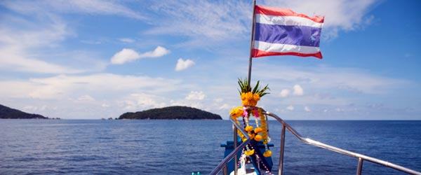 The Thai flag flailing in the wind on the liveaboard. Photo credit Kim Campbell