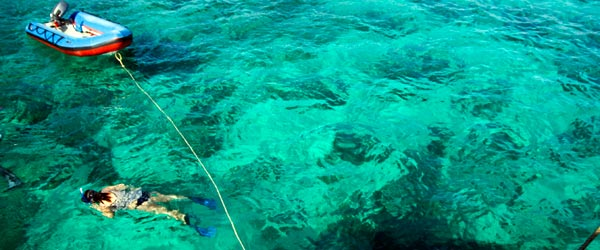 Snorkeling in the crystal-clear green waters of the islands. Photo credit Kim Campbell