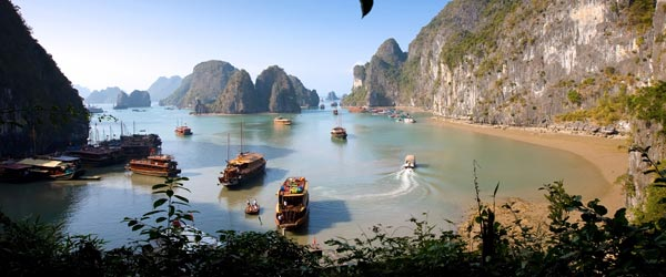 Thousands of limestone islands jut out from the sea in Halong Bay.