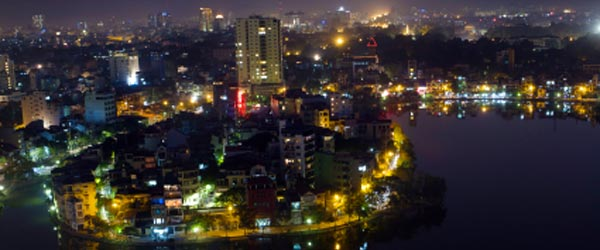 Night time aerial view of Hanoi. The city is known for its many lakes.
