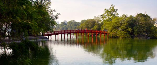 A small bridge leading to a temple on Hoan Kiem Lake.
