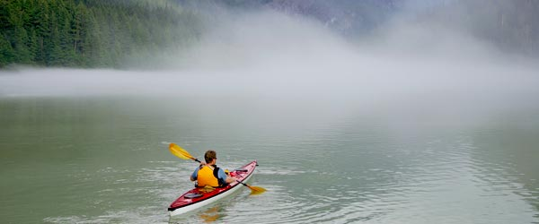 A man kayaking in the Bow Valley near Banff, Alberta.