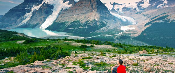 A man looking out at Mt Robson, the highest point in the Canadian Rockies.