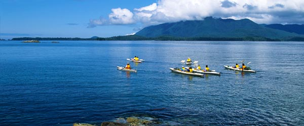 A group of kayakers set out for an adventure on the sea in Tofino.