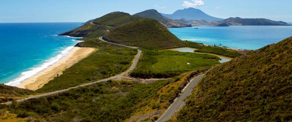 The coastline of Saint Kitts with the volcanis Nevis Island in the background.