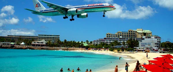 A plane coming in for a landing at Sint Maarten's Princess Juliana Airport.