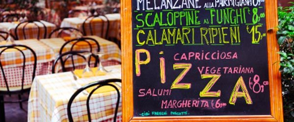 Rome is famous for its pizza. See why at an al fresco pizza restaurant.