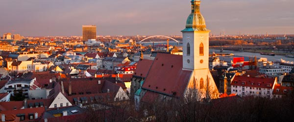 Bratislava's Old Town, St Martin's Cathedral and the Danube at sunset.