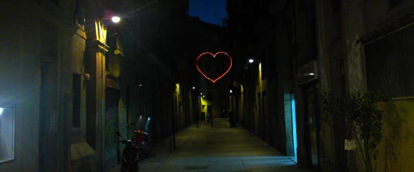 A neon heart displayed by residents on a street in El Raval.