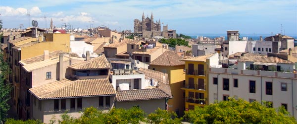 A view across Palma with the Cathedral of Santa Maria in the distance. Photo credit Gordon Wrigley / CC BY 2.0.