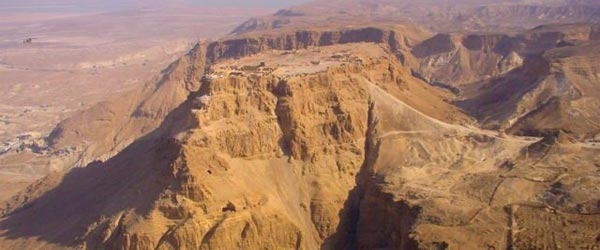 A view of Masada. Notice the ramp made of earth that was constructed by the Romans to breach the fortress.