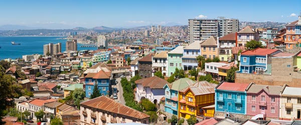 The beautiful and colorful historic quarter of Valparaiso with the coast in the background.