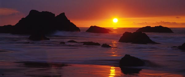 A beautiful sunset as seen from a rocky beach in Malibu.