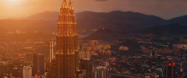 The sun glittering off the Petronas Twin Towers in Kuala Lumpur.