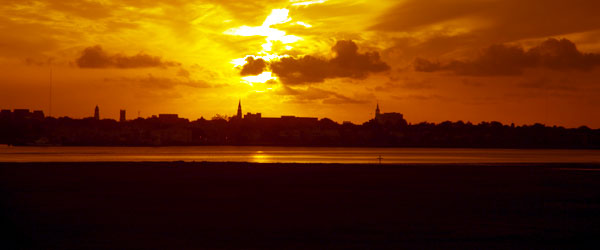 Historic, seafront Charleston against the backdrop of a gorgeous sunset.