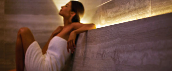 A woman relaxing in the sauna of the Spa at the Four Seasons Hotel in Toronto.
