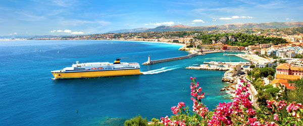 A cruise ship pulling out of the picturesque port in Nice.