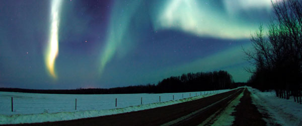 The northern lights seen from a country road on a stunning night.