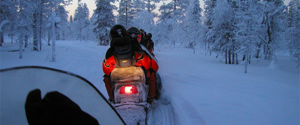 Snowmobiling through the frozen forest of the Lapland. Photo credit Timo Newton-Syms / CC BY-SA.