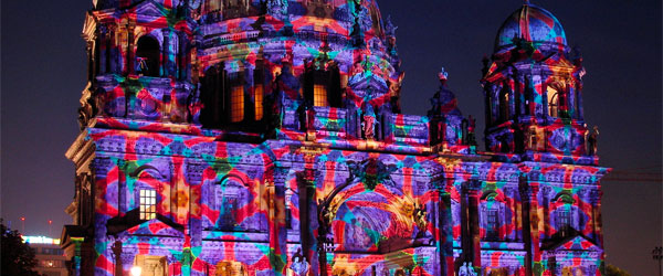 The Berlin Cathedral, in the trendy neighborhood of Mitte, lit up in a colorful light display. Photo credit Gertrud K. CC SA.