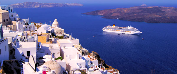 The Santorini village of Fira and a cruise ship entering the bay.