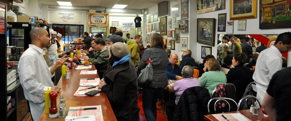 Inside the famous and always-packed Schwartz's Deli on Saint-Laurent Boulevard.