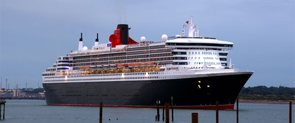 A ship belonging to Cunard Cruise Lines setting sail from its port in Southampton.