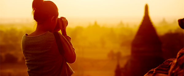 A young woman photographing the spectacular Bagan Plains and its many temples.