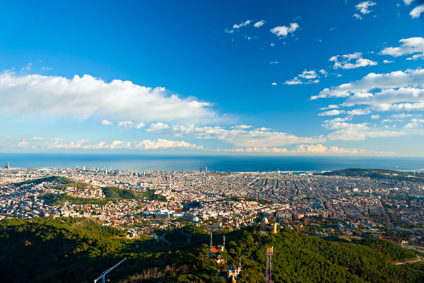 View of the entire city of Barcelona with the Mediterranean Sea in the background.