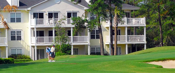 Golfers lining up their shots at the Brunswick Plantation and Golf Resort.