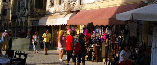 Tourists walking on the streets of Kassiopi. Photo credit Stefan Radu.