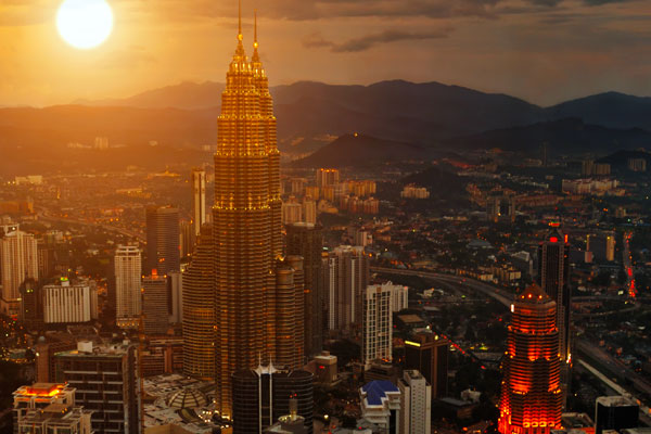 A sunset over Kuala Lumpur and the Petronas Twin Towers.