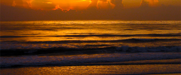 This peaceful sunset at New Smyrna Beach conceals the shark-infested waters.