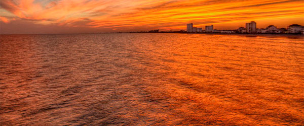 A stunning sunset over North Myrtle Beach. Photo credit Jason Barnette Photography / CC SA.