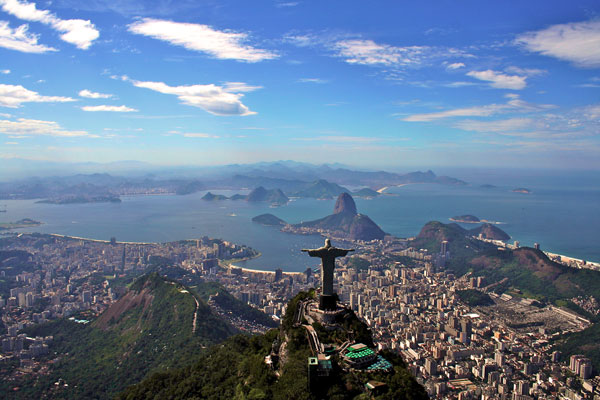 An aerial shot of Rio de Janeiro and the Christ the Redeemer statue.