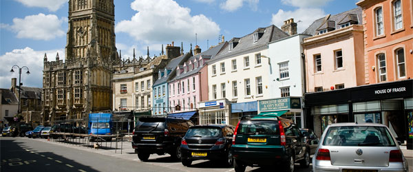 The small shop houses of Cirencester with the St John Baptist Church on the left. Photo credit Andrew Stawarz.