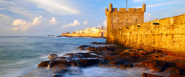 The city walls and fortifications of Essaouira at sunset.