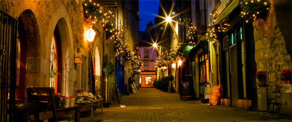 A quiet street inside the historic city center of Galway.