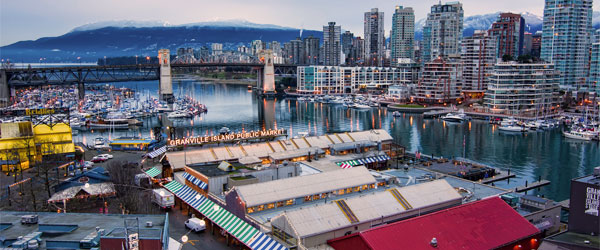 Granville Island and its famous market host the ships of Wild Whales Vancouver. Photo credit James Wheeler / CC BY-SA.